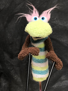 Green striped sock puppet with brown arms