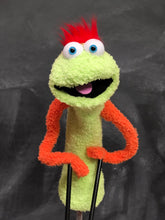 Green sock puppet with orange arms and red hair