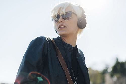 Young Glamour Woman Wearing Headphones