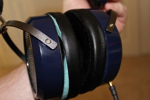 Holding High End Headphone Covers
