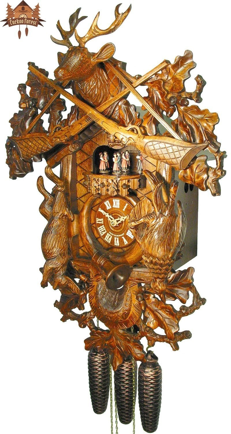 8-Day Musical Carved Clock Stag and Rifles 24 inch - German Cuckoo Clocks