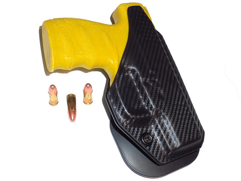 Aggressive Concealment outside the waistband paddle holster for Walther