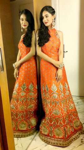 Image of Amrita Rao at a Navratri event wearing a Yoshita Couture Burnt Orange Anarkali