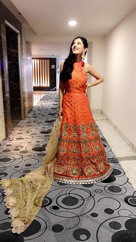 Images of Amrita Rao at a Navratri event wearing a Yoshita Couture Burnt Orange Anarkali