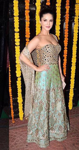 Image of Sunny Leone is Yoshita's Cape & Bustier Lehenga at a Diwali Party