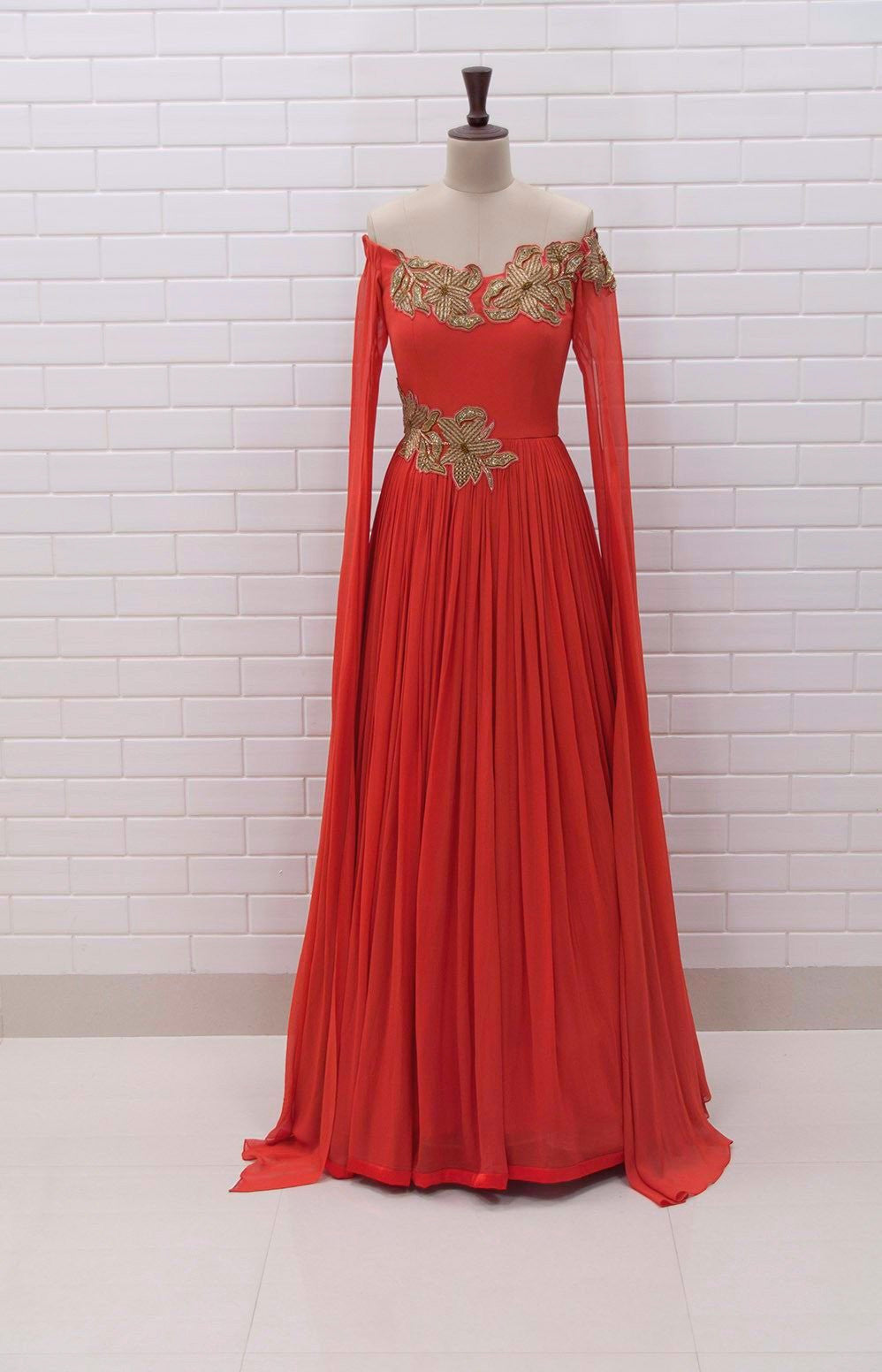TAZIA : Rust coloured off shoulder long drape sleeves gown with Zardozi embroidery