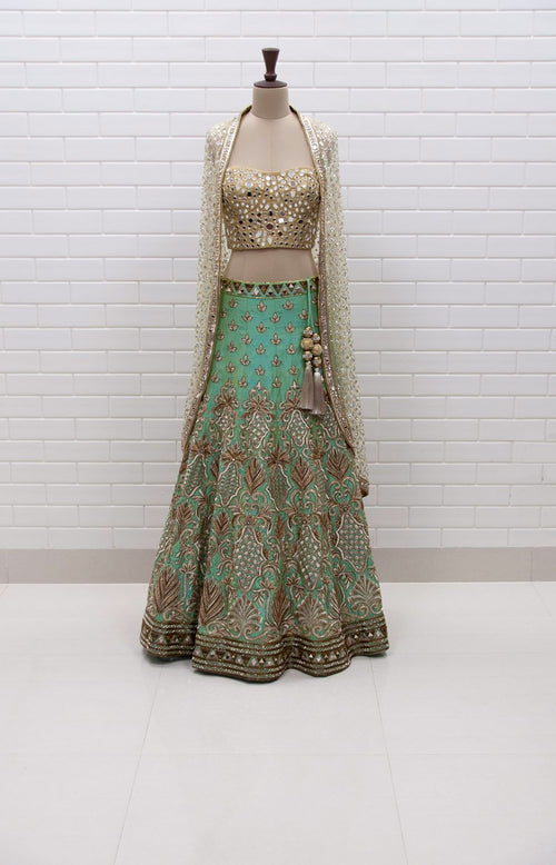 f454c3a3703e88 Sunny : Turquoise Lehenga with Mirror Corset and Kundan cowl jacket