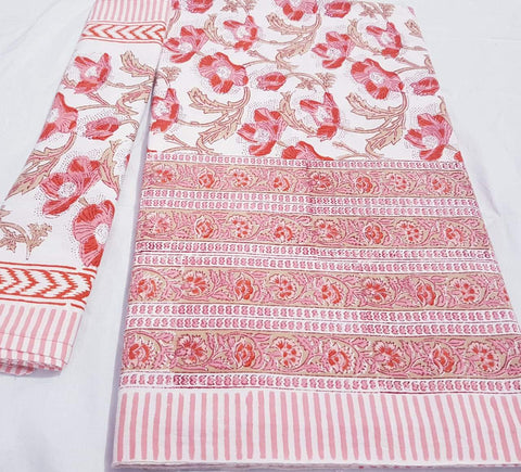 White with pink and red floral printed bedspread