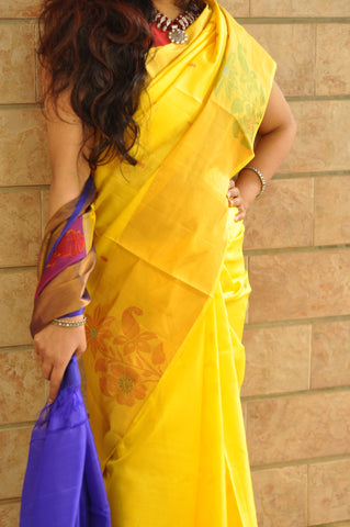 Yellow with purple khadi silk saree