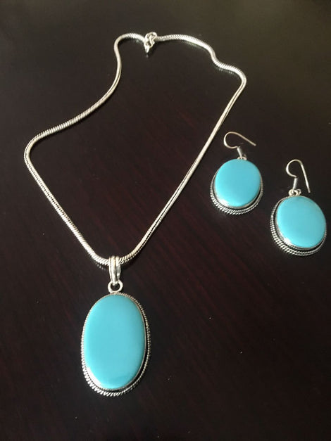 Silver toned Drop Pendant set with Blue Cut stone