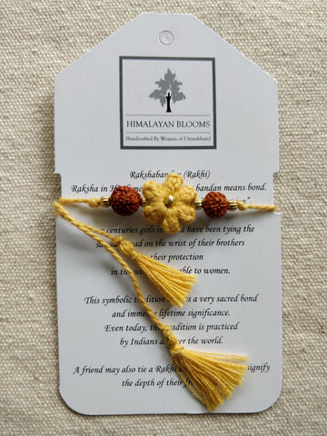 Yellow Small Embozed Flower Rakhi with Rudraksha beads