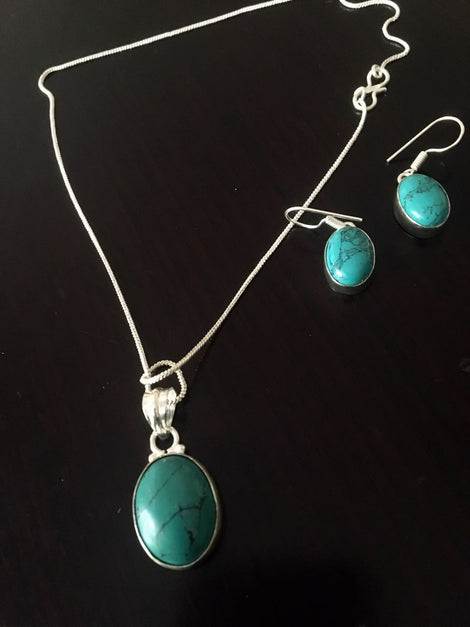 Silver toned Drop Pendant set with bluish green Cut stone & ear rings