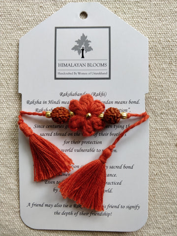 Rust Small Embozed Flower Rakhi with Rudraksha beads