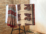 Beige with brick red Zari border Kalamkari Sarees