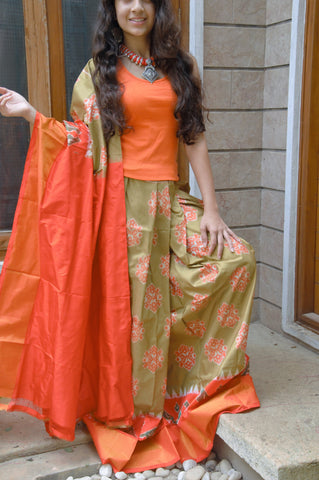 light brown color and orange Ikkat silk lehenga with orange choli