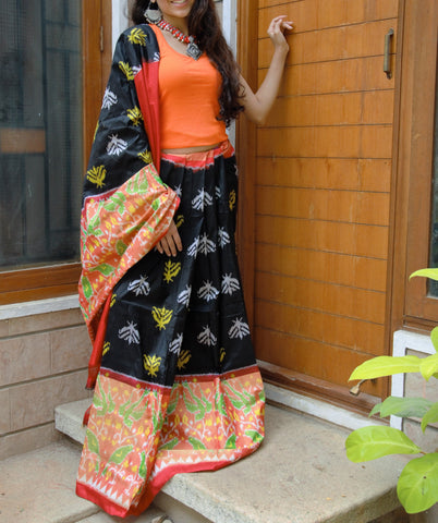 black and red silk lehenga with orange choli and motifs