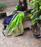 Green and black silk lehenga with choli and motifs