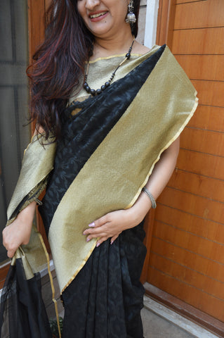 Black Tissue net saree with golden border
