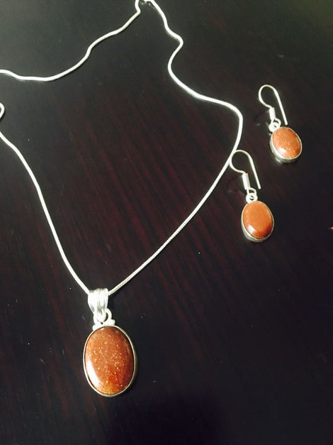 Silver toned Drop Pendant set with Brown Cut stone & ear rings