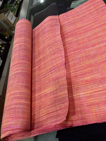 Peachish pink khadi cotton fabric