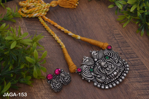 Lakshmi pendant thread necklace with earrings