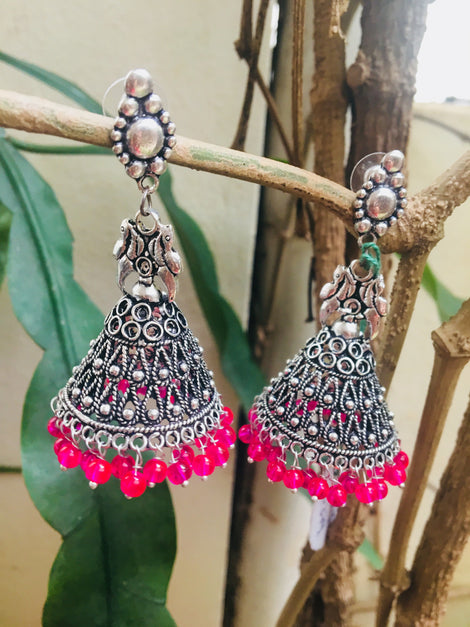 German silver large pink Jhumka with conch stud