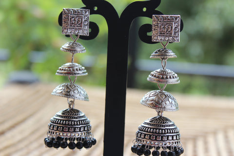 4 tier Alluring German Silver Jhumkas (Black Beads)