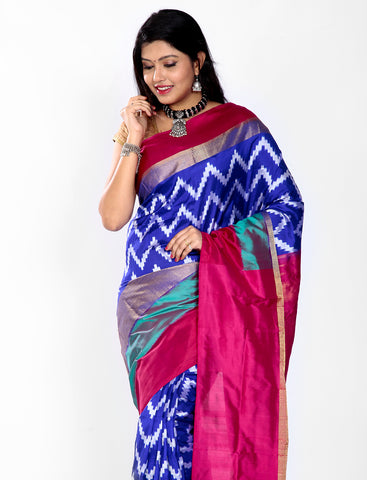 Blue ikkat silk saree with magenta pallu