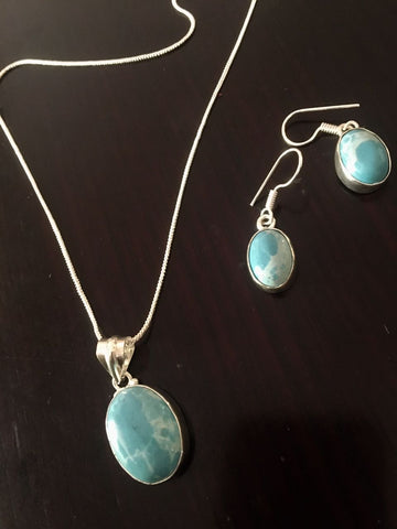 Silver toned Drop Pendant set with  Sky Blue Cut stone & ear rings