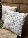 White cutwork cushion cover