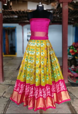 Mustard yellow and pink Ikkat silk lehenga with choli