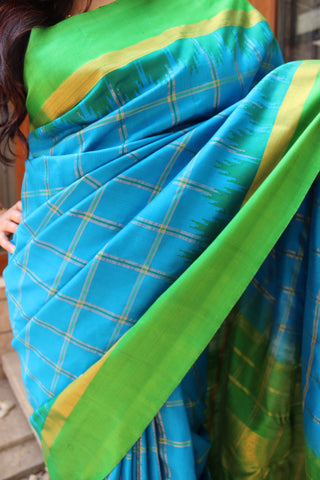 appealing sapphire blue with green pure gadwal silk saree