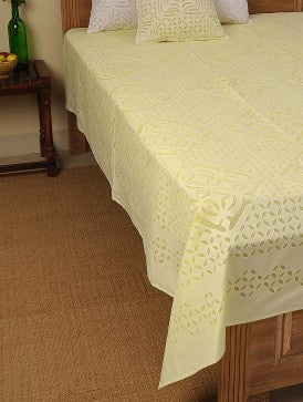 beige bed cover with applique work