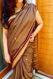 clay brown handloom cotton ilkal saree with multicolour handembroidered pallu with tassels