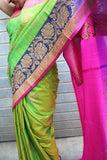 green banaras dupion silk saree with contrast magenta border with antic gold zari