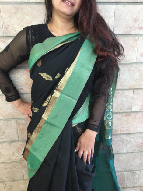 Black cotton silk saree with green border