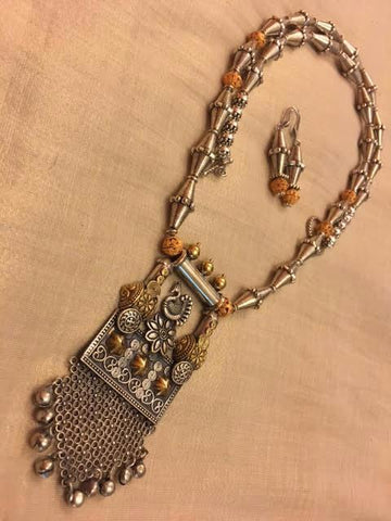 Silver replica of pendant in German silver with Tibetan beads