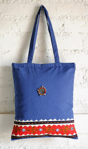 light blue hand embroidered bag