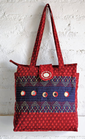 maroon and blue hand embroidered bag