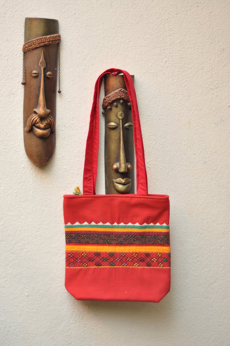red cotton shoulder bag with traditional look