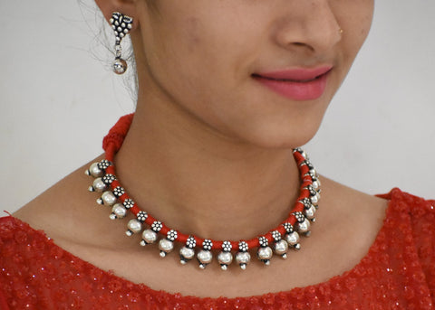 Small beads necklace in orange dhori with earrings