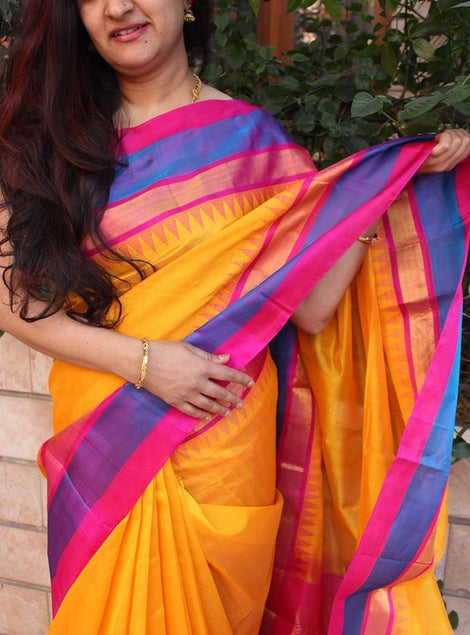 yellow kanchevaram silk cotton saree with pure zari