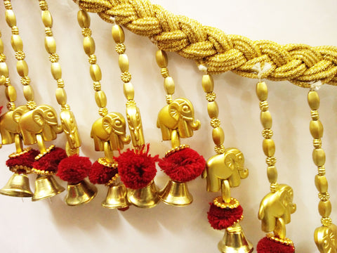 This is traditional decorative hanging known as Toran. It is a handmade item made up of colorful shaped articles and pearl beads. This can be hanged on doors as well as walls and can be used on many occasions like Diwali Decoration, Navratri, Pooja, Festivals, House Warming, Parties, Marriages, and inaugurations. Decorate your home/doors during the festive season and bring good luck to your home with this auspicious and elegant door hanging/Toran.