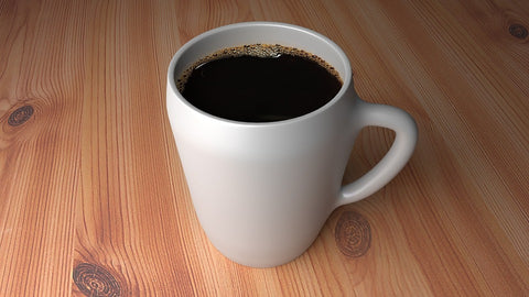 black coffee has 5 calories. cup of black coffee. white mug on a wooden table.