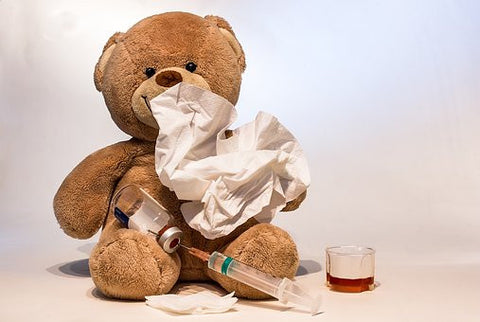immunity. water helps boost immunity. image of teddy bear with needle and other items indicating sickness and health.