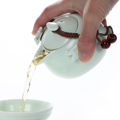 Pour tea brew from ceramic teapot - ToDoTea