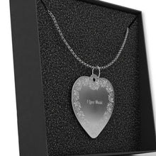 Load image into Gallery viewer, Heart-shaped necklace on black bacground.
