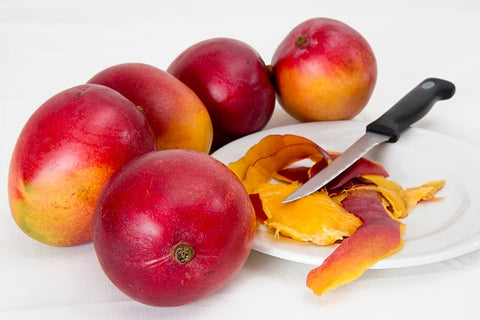 myrcene terpenes cutting mango with knife on white plate