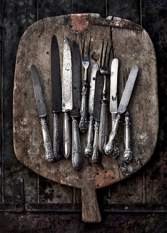 Antique chopping board and Parisian cutlery