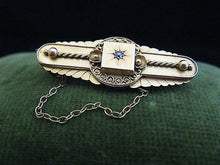A Victorian Etruscan Revival 15 Ct Gold Brooch